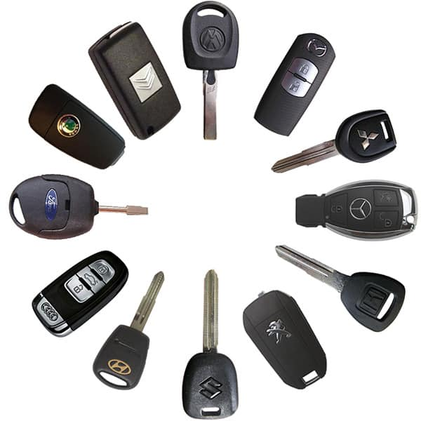 A selection of automotive remotes, fobs, and remote head keys