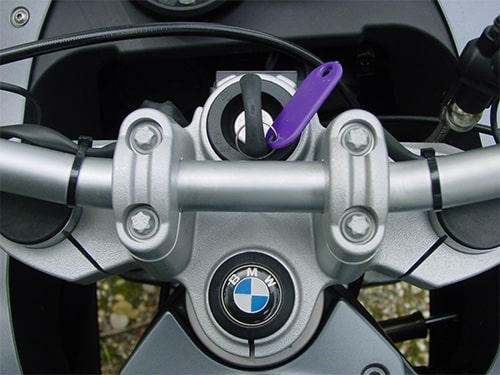 image of a motorcycle ignition lock and key