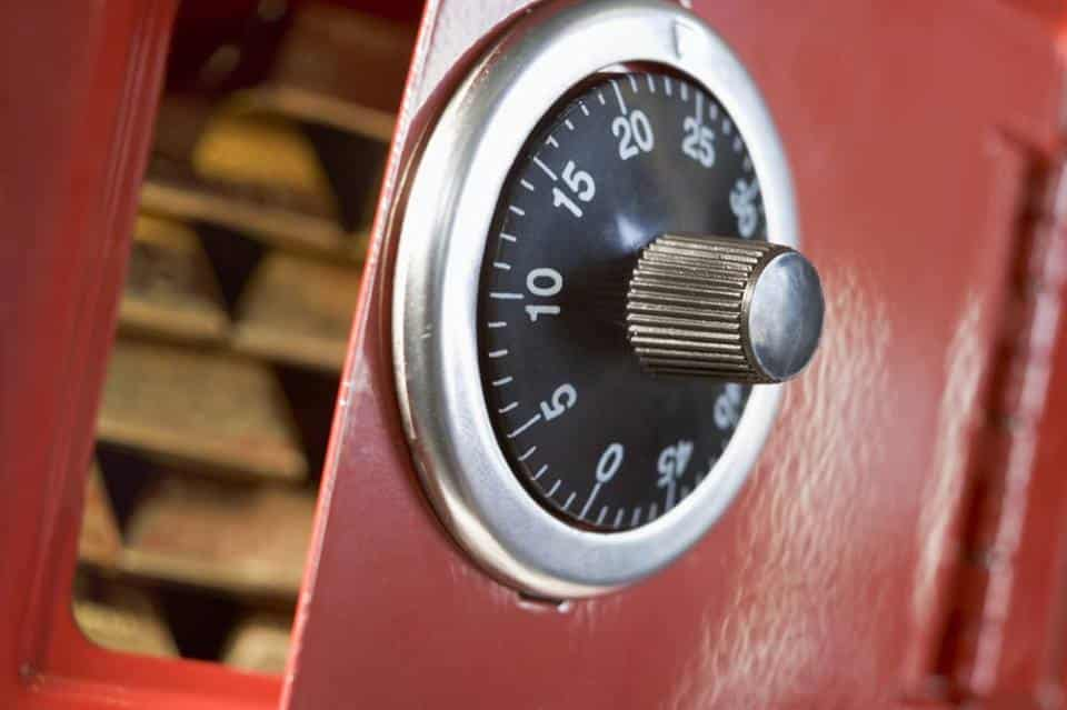 Image of an open red safe and combination lock